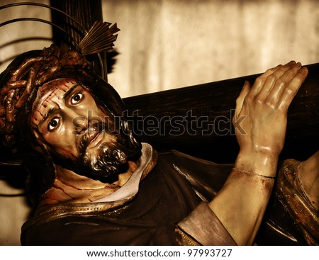 a figure of Jesus Christ carrying the holy cross - stock photo