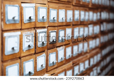 A file cabinet drawer full of files - stock photo