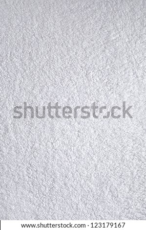 A fine texture of bright white bath towel. - stock photo
