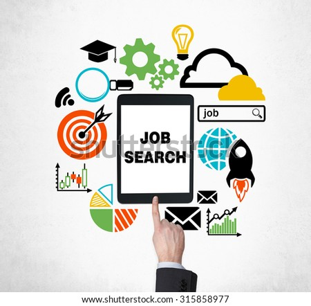 A finger is pushing the button on the tablet to find new job vacancies. Looking for a job in the Internet. The concept of searching job and technology. Internship and graduate programmes. - stock photo