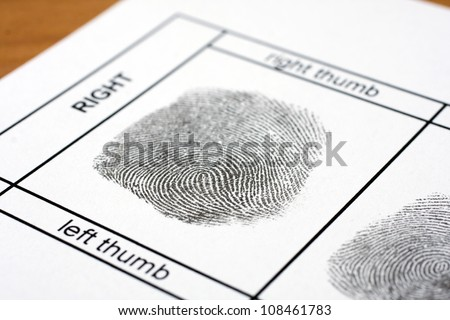 A fingerprint on a white sheet of paper - stock photo