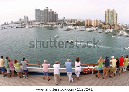 A fish-eye, wide-angle view of downtown Miami and the Port of Miami as a cruise ship sails out. - stock photo