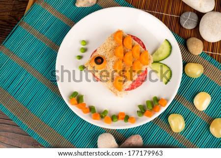 A fish shaped sandwich, healthy kid food - stock photo