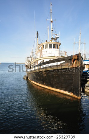 A fish ship in harbor. - stock photo