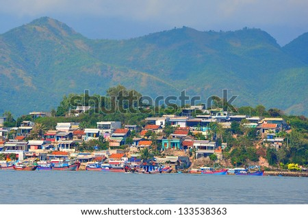 A fishing village in Nha Trang city. Nha Trang is a central city of Vietnam, famous with beautiful beaches and bays. - stock photo