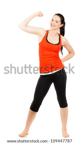 A fit beautiful sporty young woman flexing her muscles. Isolated on white. - stock photo