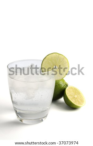 A fizzy mixed drink garnished with a lime, isolated on white. - stock photo