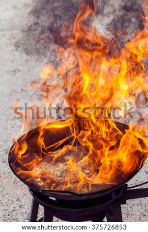 A flame burning on a gas stove - stock photo