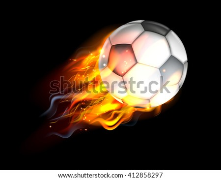 A flaming soccer football ball on fire flying through the air - stock photo