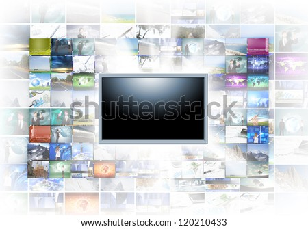 A flat screen television has a blank black text area with photo images coming out of the sides of it. The tv has a glowing light coming out the top - stock photo