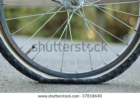 A flat tire , Puncture - stock photo