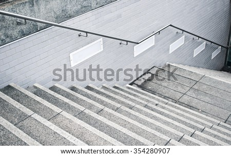 A flight of stone stairs at a subway station in Germany - stock photo
