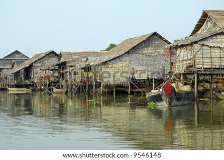 A floating village in Cambodia during the rainy season - stock photo