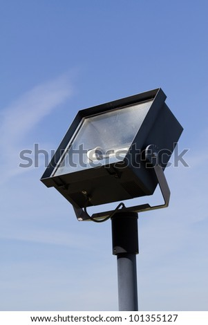 A flood light on blue sky in front of an austrian abbey - stock photo