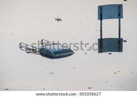 A flooded car in a parking lot at Don Mueang International Airport, Thailand - stock photo