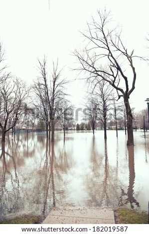 A flooded park underwater in the Chicago area on a cloudy day. - stock photo