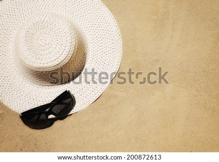 a floppy beach hat and sunglasses - stock photo