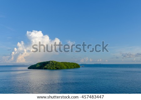 A florida keys atoll in the gulf of mexico at sunrise with large cumulus clouds in the background  - stock photo