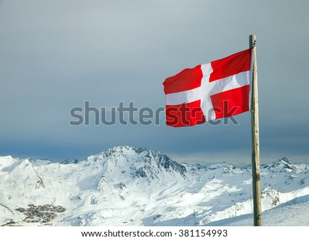A fluttering flag of Savoy in mountain ski resort - stock photo