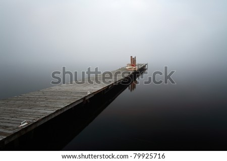 A fog covered duck bay marina on the shores of Loch Lomond - stock photo