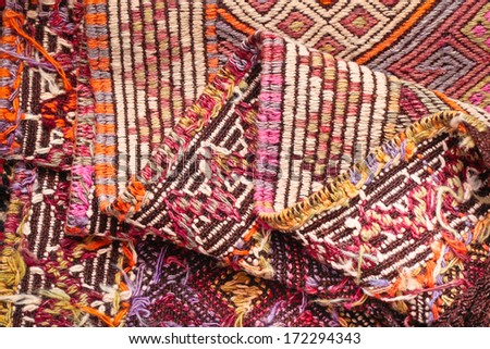 A folded kilim rug as a background - stock photo