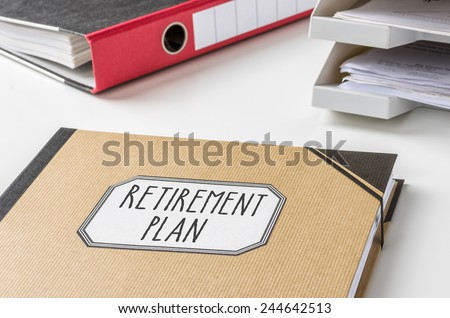 A folder with the label Retirement Plan - stock photo