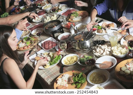 A fondue dinner with friend on a beautiful place - stock photo