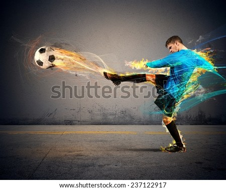 A football player throws fireballs at opponents - stock photo
