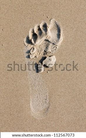 A footprint on the beach of the Mediterranean sea - Israel - stock photo