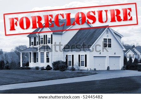 A foreclosed house with a red foreclosure stamp running along the top of the picture. - stock photo