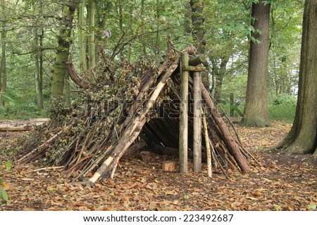 A Forest Shelter Made From All Natural Materials. - stock photo