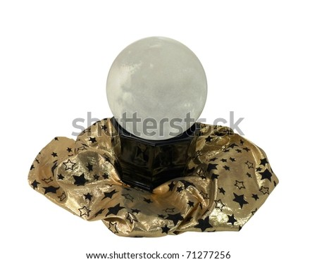 a fortune teller's crystal ball on a gold shimmery cloth with stars isolated on a pure white background - stock photo