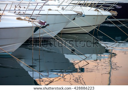 A fragment of yacht marina with yachts bows - stock photo