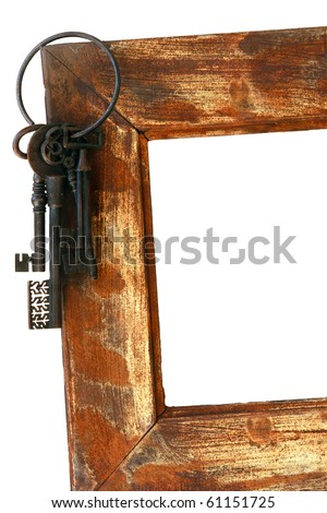 a Frame with a  vintage key set on edge - stock photo