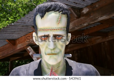A Frankenstein statue on sale at Charlie Brown Farms, a gift and souvenir shop on the Pearblossom Highway in Littlerock, California, in the Antelope Valley. - stock photo