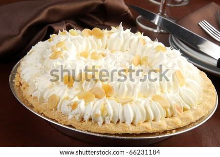 A fresh banana cream pie in an elegant setting - stock photo