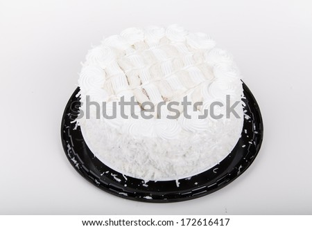 A fresh, delicious coconut cake on a white table or counter - stock photo