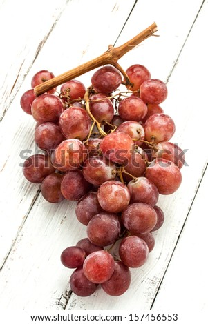a fresh grapevine on a wood background - stock photo