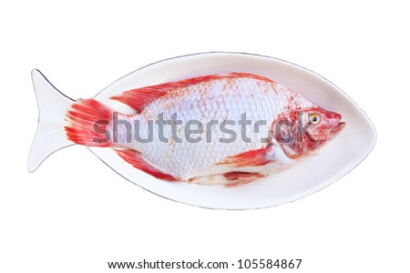A fresh ruby fishes after remove the scales in the ceramic fish shaped dish, preparing for cooking. - stock photo