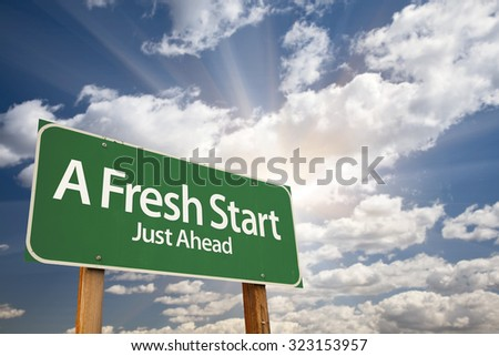 A Fresh Start Green Road Sign With Dramatic Clouds and Sky. - stock photo