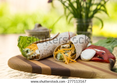 A fresh wholesome summer lunch outdoors on the patio in the garden. - stock photo