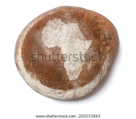 A freshly baked loaf of bread covered with rye flour in the shape of Africa.(series) - stock photo