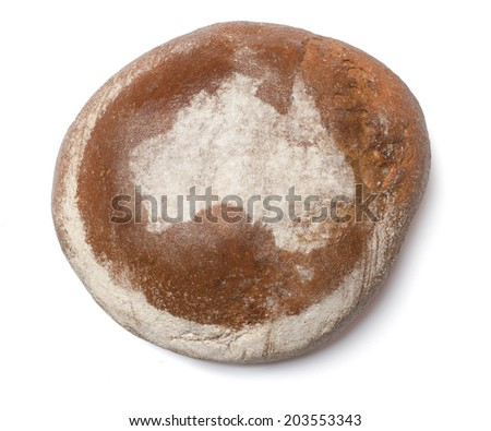 A freshly baked loaf of bread covered with rye flour in the shape of Australia.(series) - stock photo