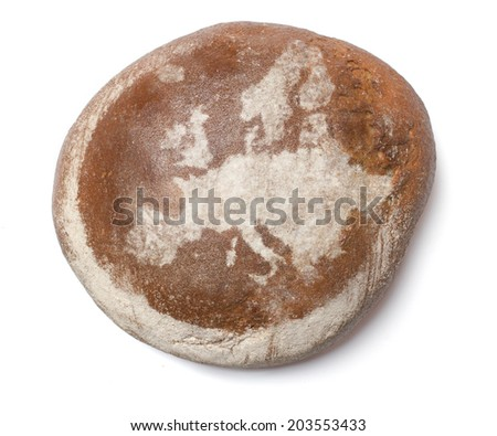 A freshly baked loaf of bread covered with rye flour in the shape of Europe.(series) - stock photo