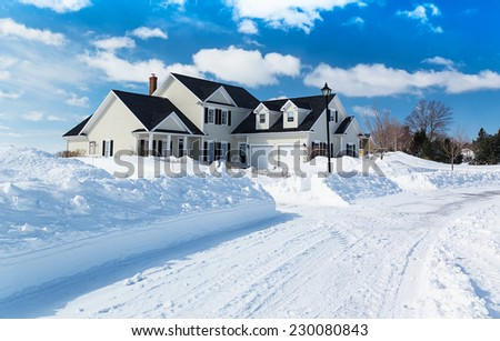 A freshly plowed road in America suburbia after a snow storm. - stock photo
