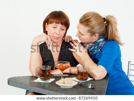 A friend comforts in a conversation over tea - stock photo