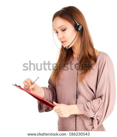 A friendly secretary/telephone operator in headphones, white background - stock photo