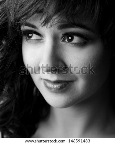 A friendly young woman - stock photo