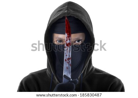 A frightening man holding bloody knife. isolated on white background - stock photo