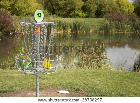 A frisbee golf target with discs in the basket. - stock photo
